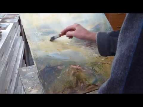 Artist Steve Slimm glazing a landscape painting with oil paint – Cornwall, UK