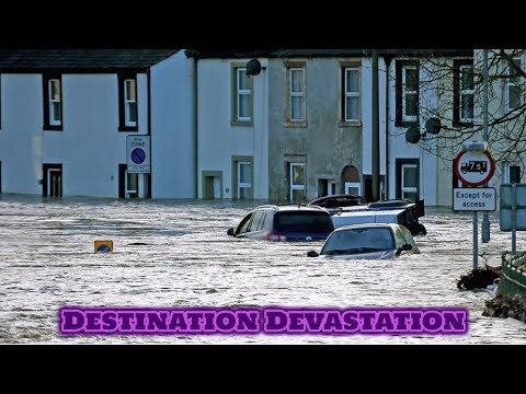 Cumbria in chaos as floods close roads and schools, strand vehicles! England.