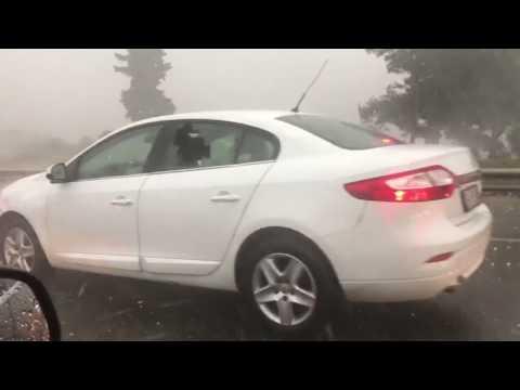 Hail Storm Damages Cars