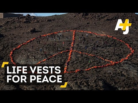 Large Peace Sign Made Of Thousands Of Refugees' Life Jackets