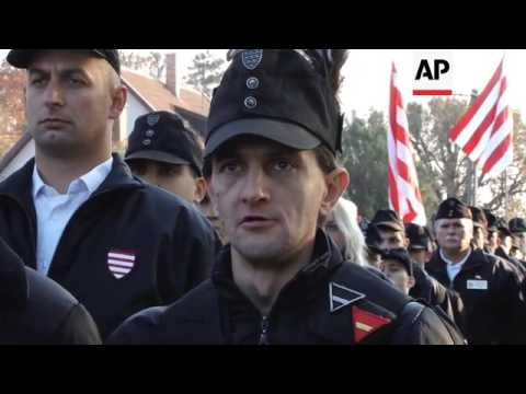 Villagers and far right members march to remember Hungary's WW2 ruler