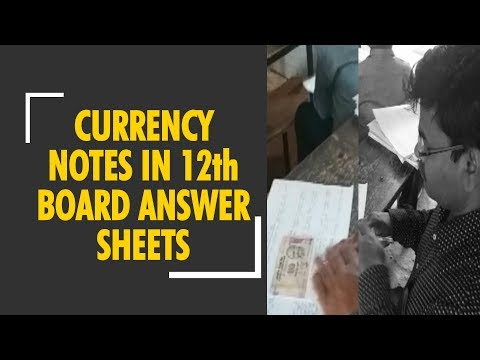 Students stuck currency notes to bribe qualifying exam