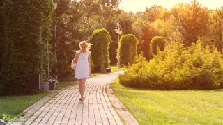 Beautiful Girl Walking Alone in the Park at Sunset 1 | Stock Footage