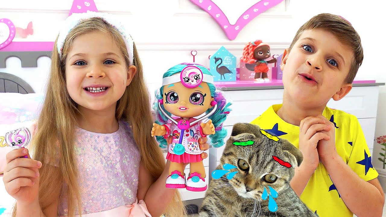 Diana plays with  Kindi Kids dolls