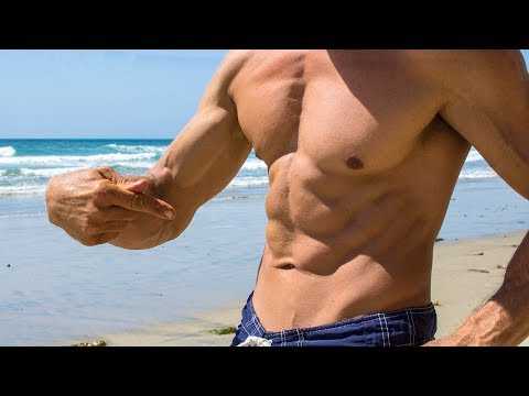 Making six pack abs at the beach
