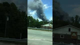 Huge smoke cloud from salvage yard fire