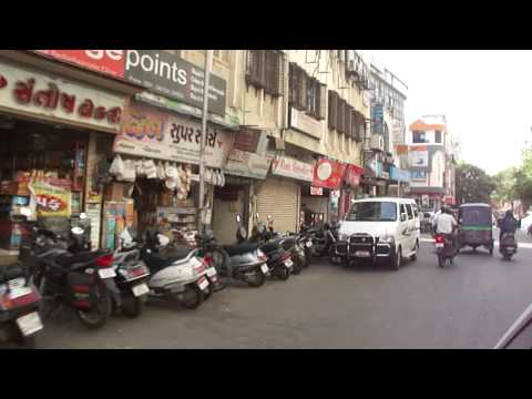 Driving in slow moving traffic jam & then clearer roads in Surat city, Gujarat, India; 23rd May 2012