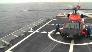 Begich Lands in Helicopter on the Coast Guard Cutter Bertholf