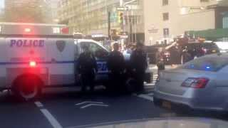 NYC Police Officers gather outside the NYC medical examiner . 5/4/15