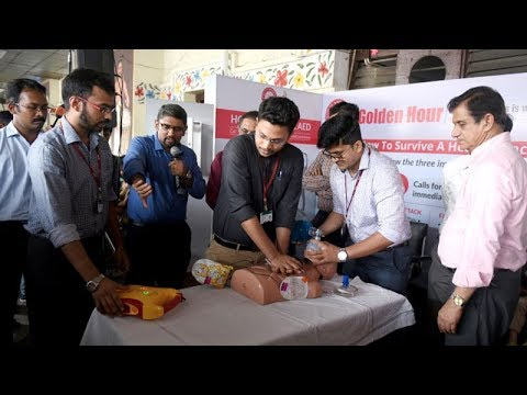 Doctors demonstrate the use of AED to treat cases of heart attack