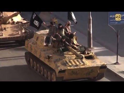 Islamic State militants parade in their Syrian stronghold