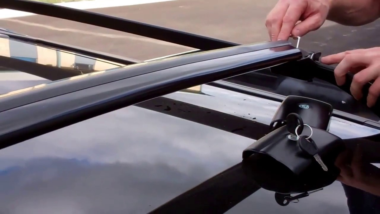 How to fit cross bars to Land Rover Freelander 2 roof rack ...
