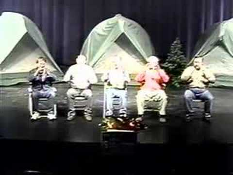 The adult Boy Scout Leaders sing VISTA! song