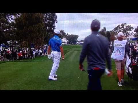 Gary Woodland drives it 323 and throws club