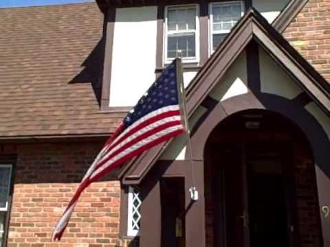 American flag on our house & neighbor's black cat...