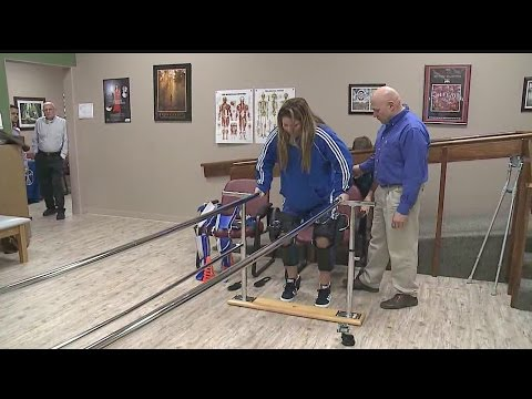 Paralyzed woman takes first steps with help of special brace