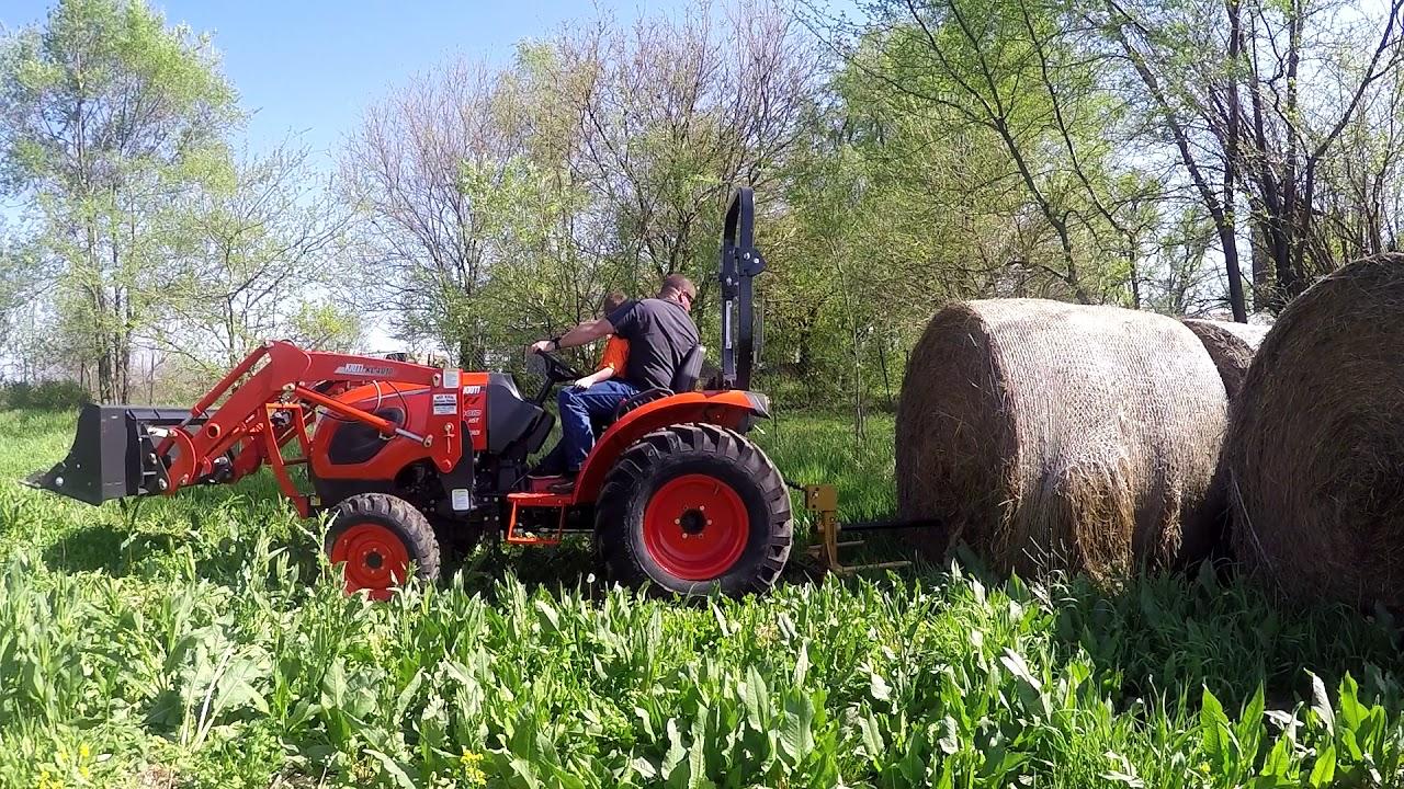 Kioti CK4010 vs 1700 pound hay bale