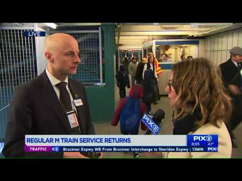 NYC transit head greets riders at reopened M train station