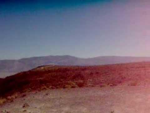 MILITARY-PLANE flyin among the rocks in Nevada etc. Clip 2