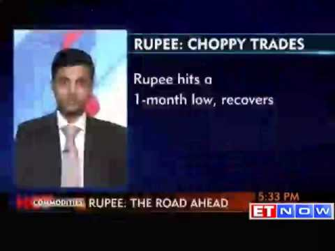 Rupee off 1 month lows on suspected RBI intervention