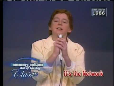 "Scott Grimes singing on ""Community Auditions"" in 1986"