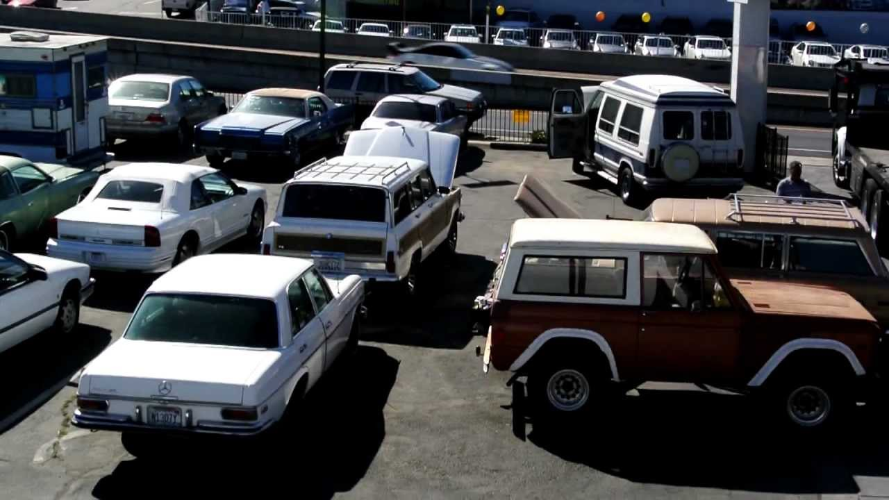 classic 1970s 1980s car lot old bronco wagoneer lincoln mercedes oldsmobile