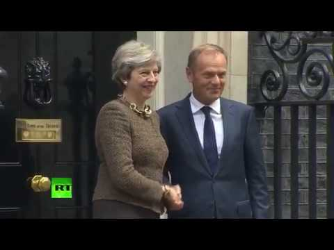 Theresa May greets EU president Donald Tusk ahead of Brexit talks