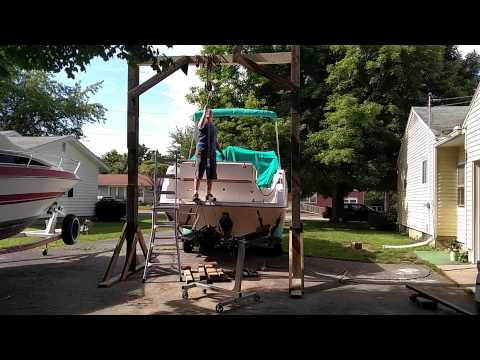Removing 454 from boat with homemade hoist.