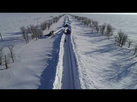 Расчистка дорог в Палласовском районе Волгоградской области от снега.