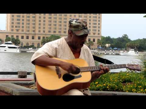 """Walter Harris singing Louis Armstrong's """"What A Wonderful World"""" on River Street."""
