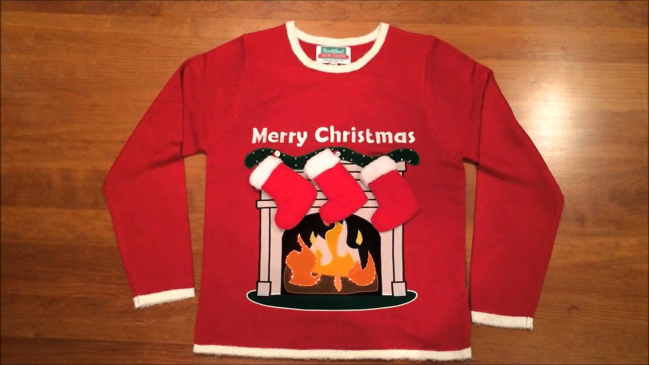 This festive sweater features 3D stockings atop a lighted (LED) fire! The fire comes to life with the flick of a switch (hidden in a pocket inside the sweate...