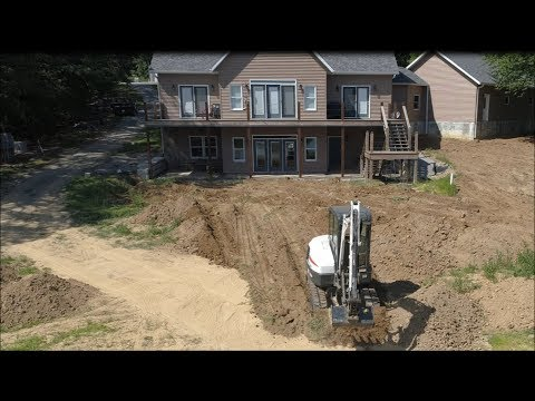 DIY Grading fresh dirt for new lawn project; Bobcat E42 Excavator