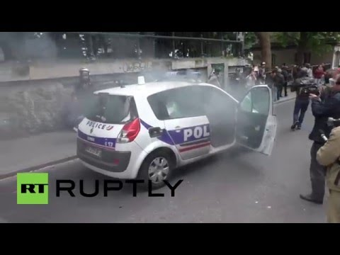 France: Moving police car smashed up, set on fire during Paris protest