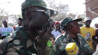 Close up of military veterans chanting slogans in support...