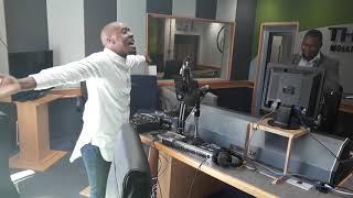 THOBELA FM STUDIO- Mpho Majiga & presenter Kgaogelo Mathontsi.  Song- Great is the Lord.