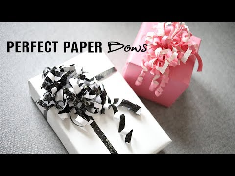 HOW TO MAKE CURLY BOWS OUT OF WRAPPING PAPER!