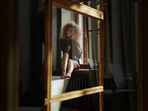 Download girl sitting young window