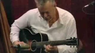 Tommy Emmanuel, Frank Vignola, and Gary Mazzaroppi playing on Woods...