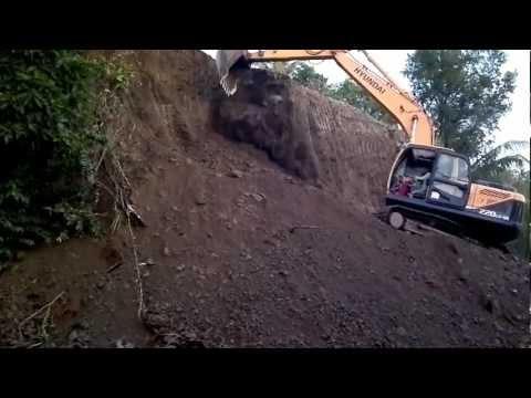 HYUNDAI R220LC-9 Backhoe doing roadway excavation works. Part 1