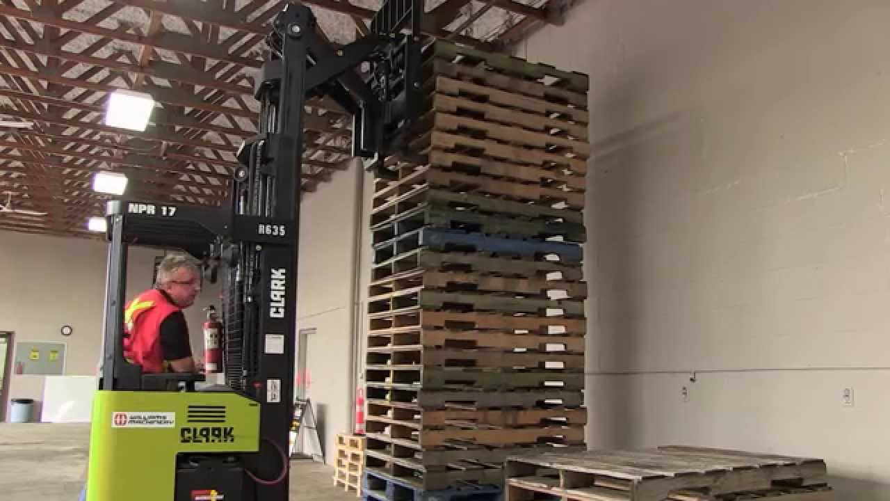 Narrow Aisle Reach Forklift Moving A Load Youtube