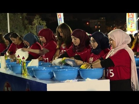 Algeria cleans up with mass dish washing record
