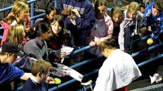 Dinara Safina signs autographs after her match in New Haven 2010