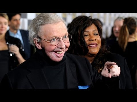 Film critic Roger Ebert and wife give an interview