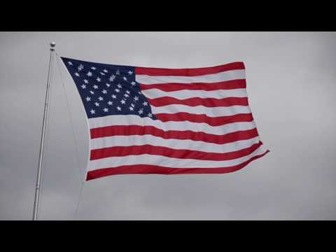 American flag flaps during heavy wind storm