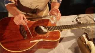 frank ford instructs how to install a clear pickguard on an acoustic guitar