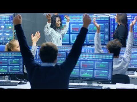 Multi-Ethnic Team of Traders Have Successful Day at the Stock Exchange Office. | Stock Footage -