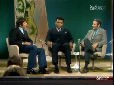 Muhammad Ali talks with Joe Namath in 1969