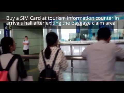 Buy a prepaid SIM card with data at Beijing Airport tourist counter