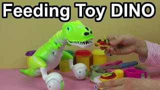 Feeding my Toy Robot Dino Pet with Play-Doh Hot Dog, Pizza, Hamburger and Fish !