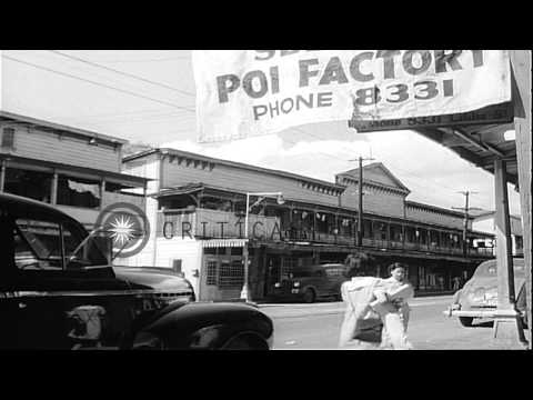 Streets with cars and pedestrians and a military truck in Honolulu, Hawaii, durin...HD Stock Footage